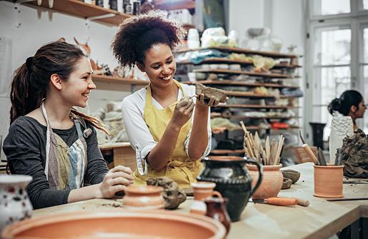 Female potters  in art studio