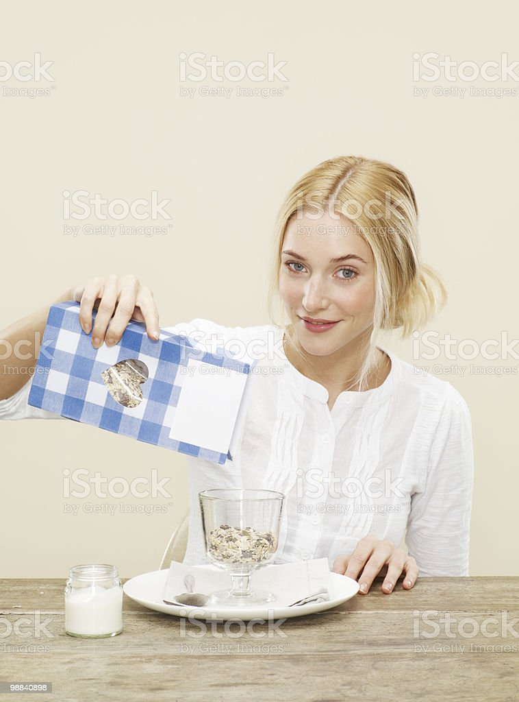 female pouring healthy cereal into a bowl 免版稅 stock photo