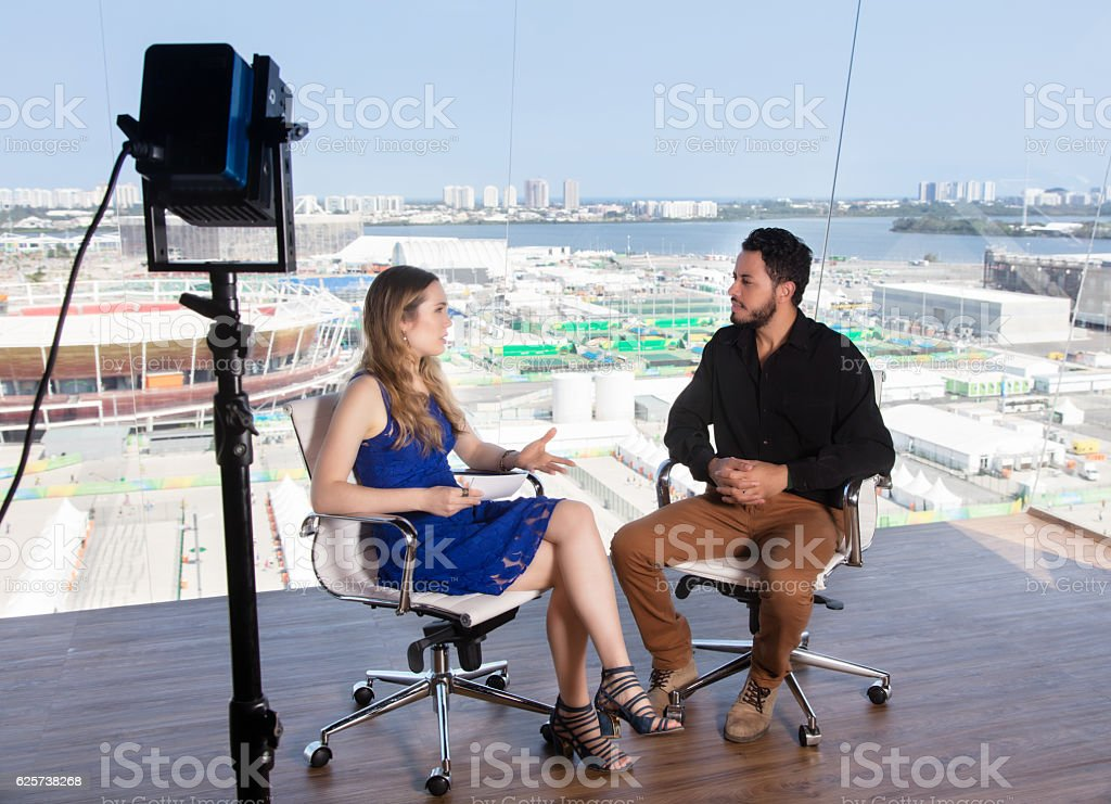 Female presenter asking a famous celebrity at tv studio stock photo