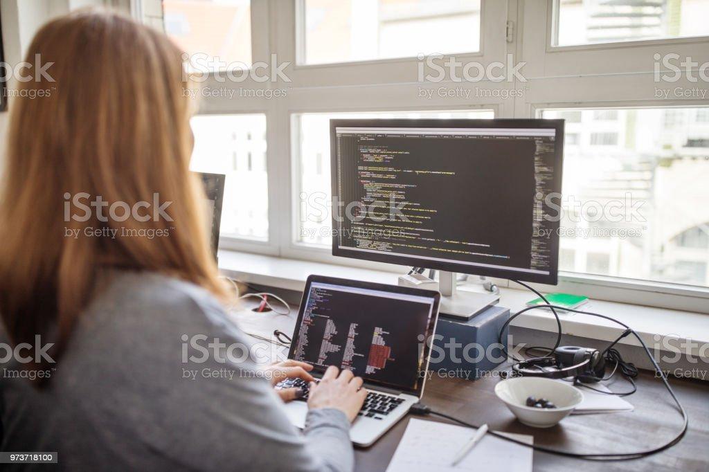 Female professional making new software program - Royalty-free 35-39 Years Stock Photo
