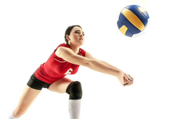 女子職業排球運動員在白色上的隔離 - 殺球 個照片及圖片檔