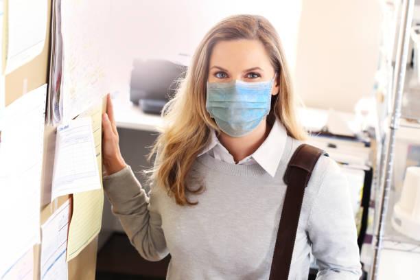 Female Professional Wearing Protective Mask stock photo