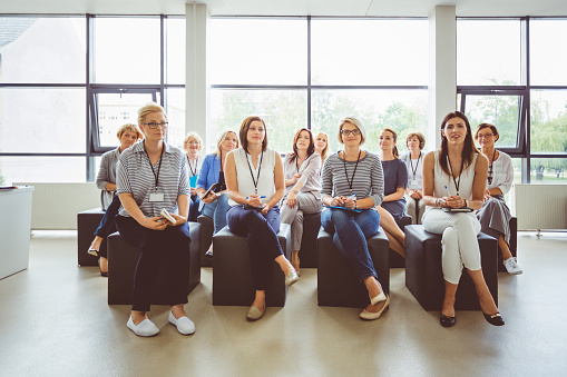 Female Professionals Attending A Seminar Stock Photo - Download Image Now