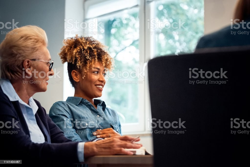 Female professionals working on start-up business Female professionals working on start-up business at desk. Entrepreneurs are looking away in office. They are planning new strategies. 35-39 Years Stock Photo