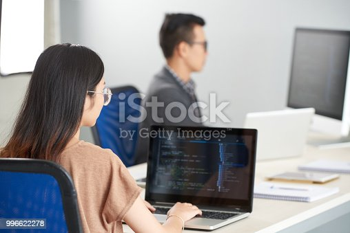 istock Female programmer working on laptop 996622278