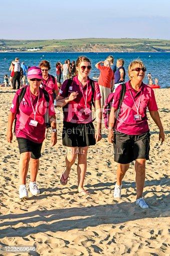 Female public advisory Volunteers on the beach in Weymouth, Dorset UK