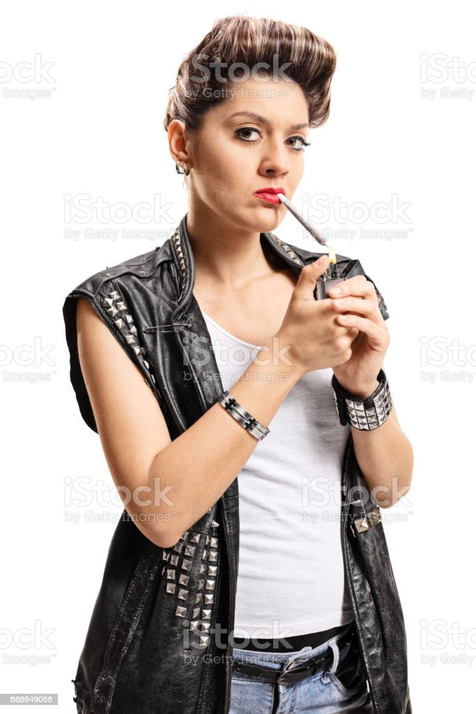 Female punker lighting up a joint with a lighter stock photo