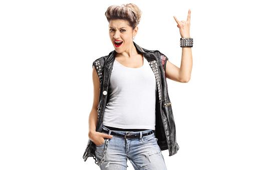 istock Female punker making a rock hand gesture 980131190