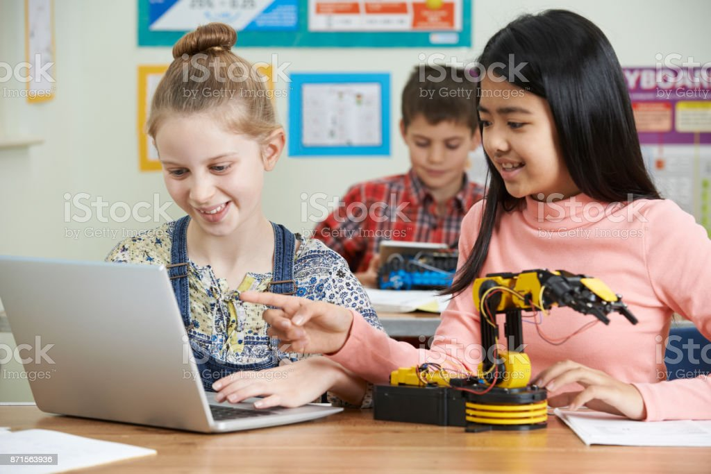 Female Pupils In Science Lesson Studying Robotics stock photo