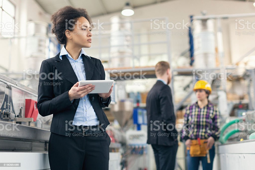 Female quality control inspector using tablet pc stock photo