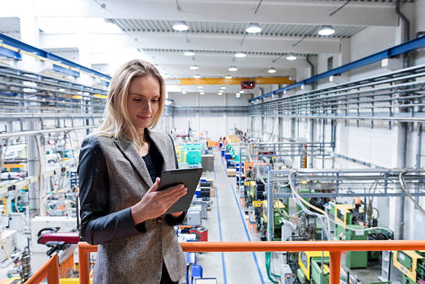 female quality inspector using tablet - computer aided manufacturing stock photos and pictures