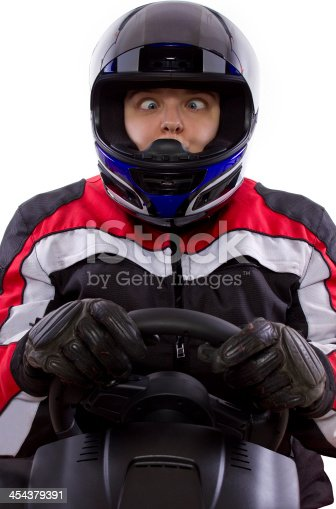 1035136022 istock photo Female Racer Wearing a Helmet on a White Background 454379391
