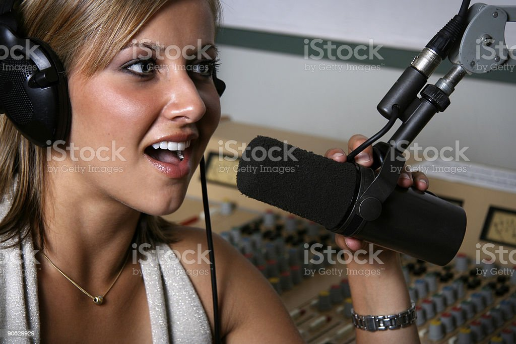 Female radio DJ at the mic royalty-free stock photo