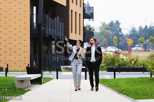 A female real estate agent showing a property for sale to her client