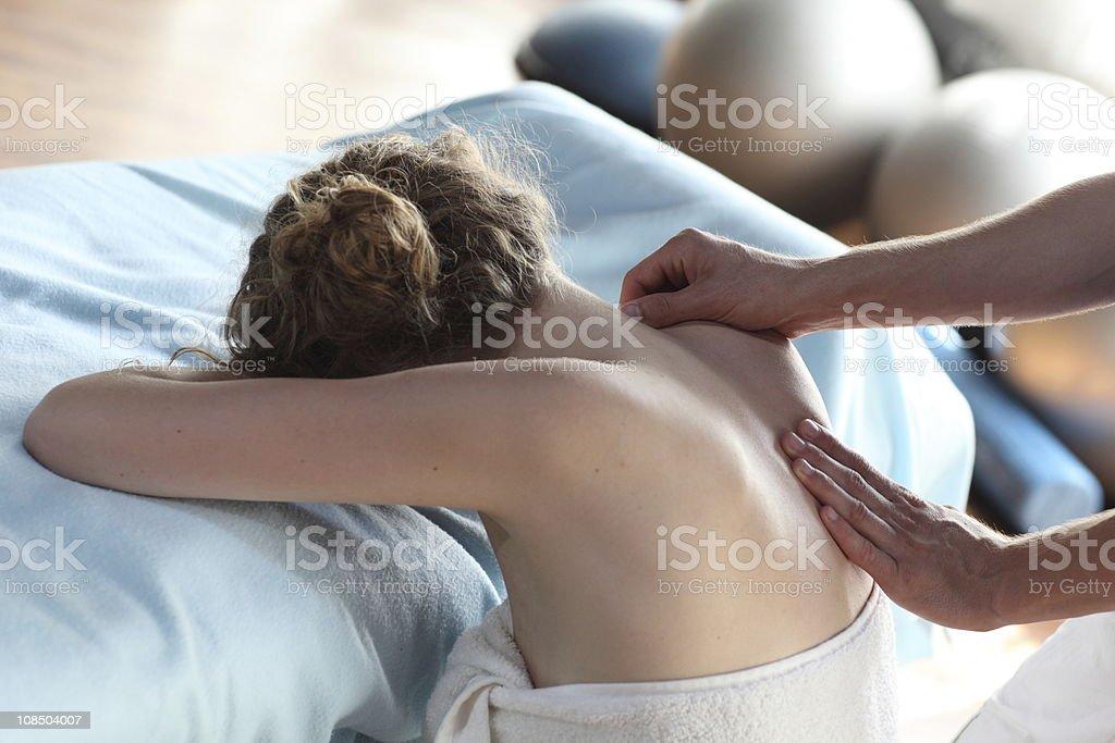 female receiving back,shoulder massage royalty-free stock photo
