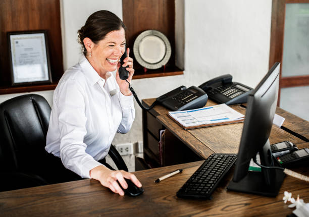 Female receptionist working at the front desk Female receptionist working at the front desk ***These documents are our own generic designs. They do not infringe on any copyrighted designs. checkout stock pictures, royalty-free photos & images