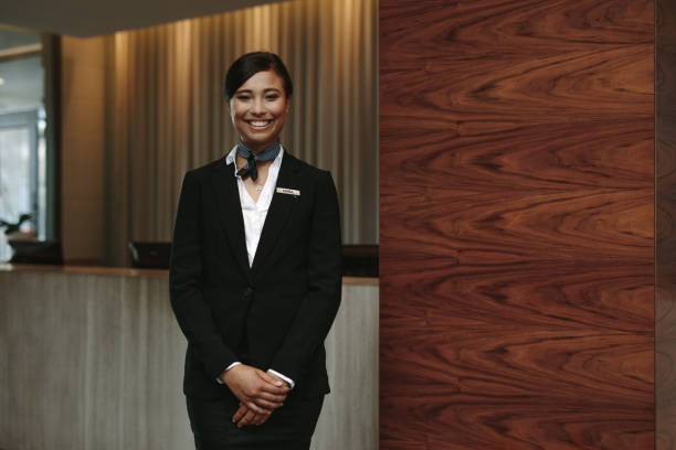 female receptionist working in hotel - receptionist stock photos and pictures
