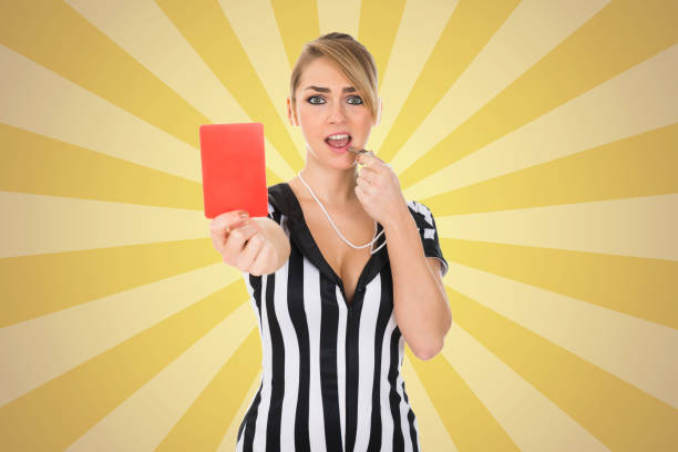 female referee holding red card - judge sports official stock photos and pictures