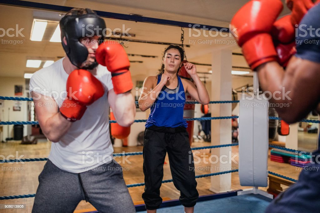 Female Referee in a Boxing Ring stock photo