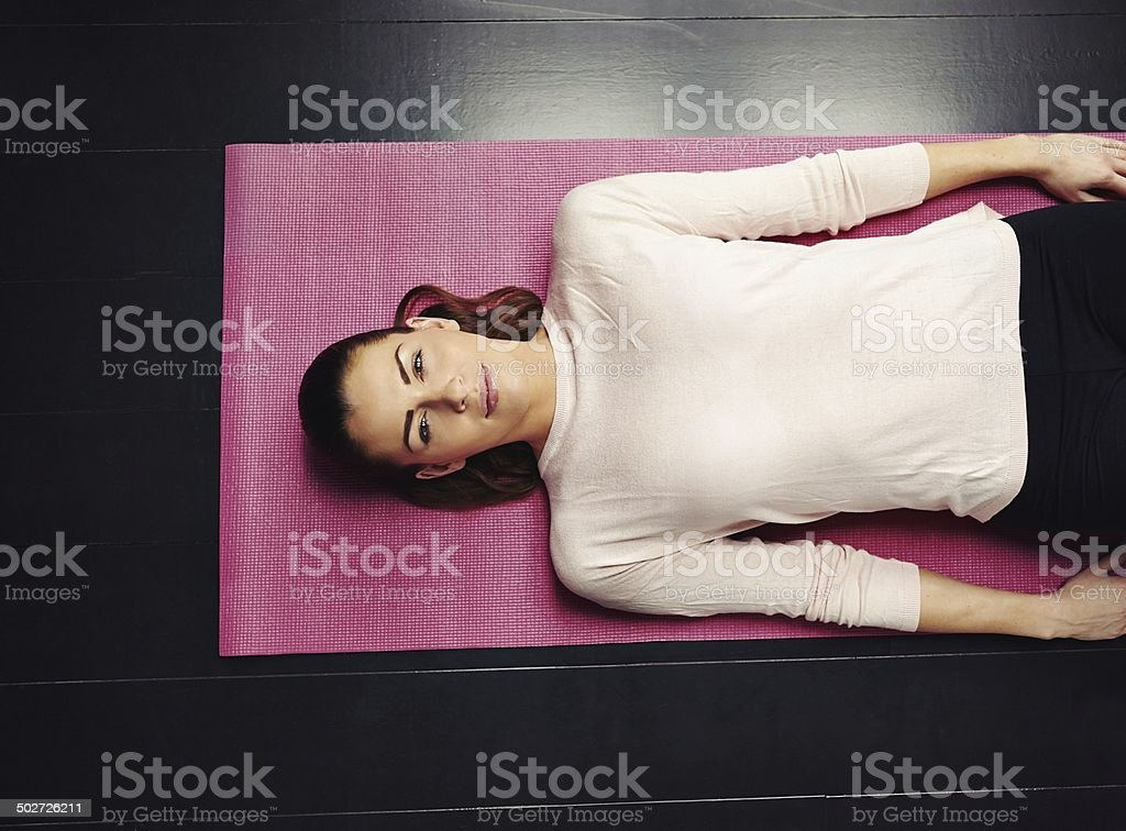 Female relaxing after workout stock photo