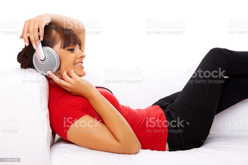 A female relaxing by listening to music on headphones royalty-free stock photo