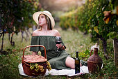 Female Relaxing On Vineyard With Good Quality Wine