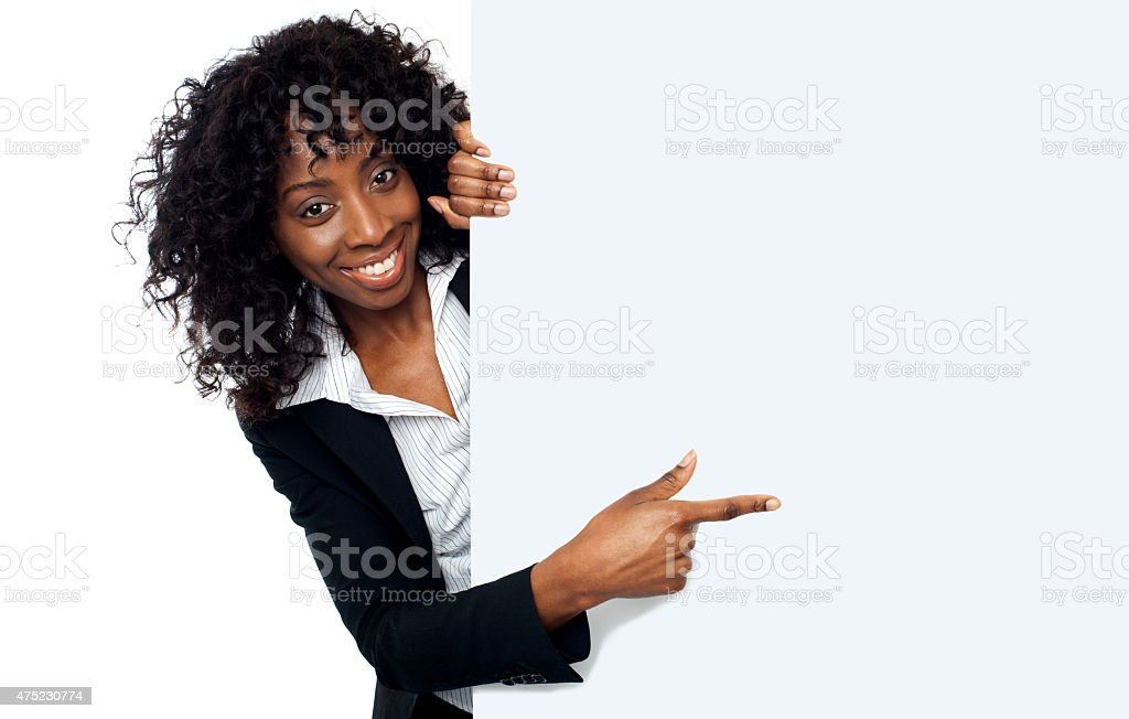 Female representative pointing towards placard stock photo