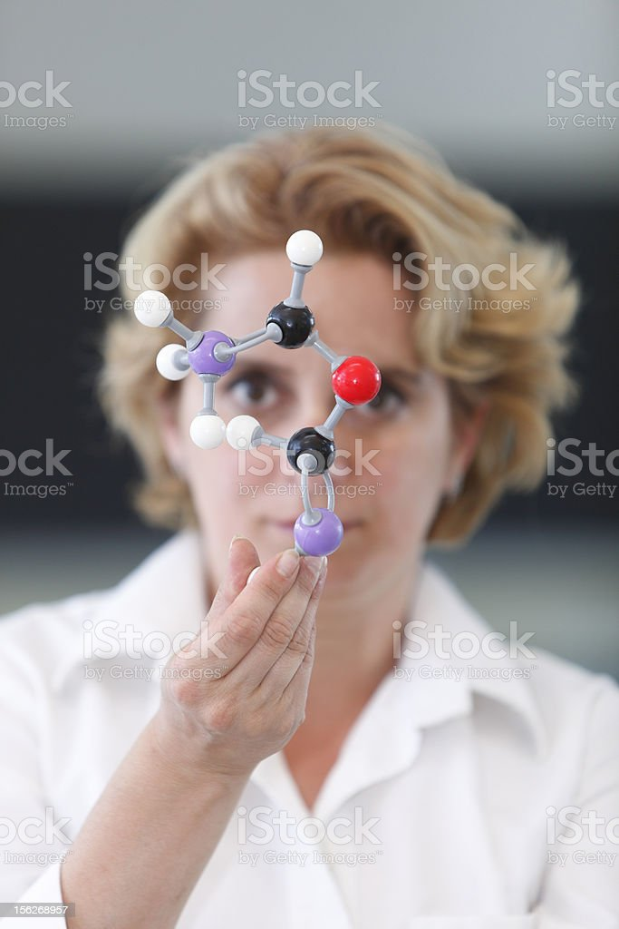 Female Researcher Analyzing A Molecular Structure stock photo