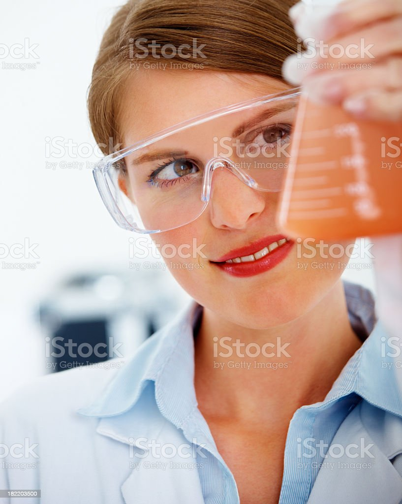 Female researcher examining a conical flask royalty-free stock photo