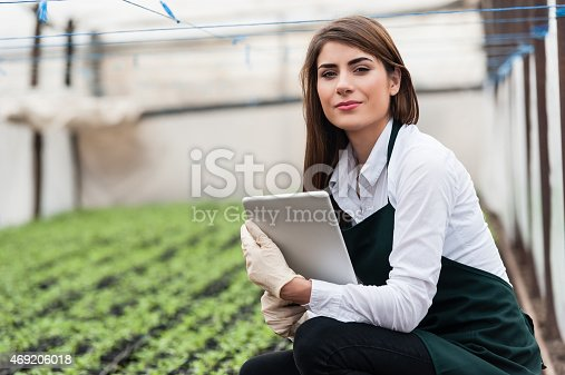 istock Female researcher technician studying with a tablet 469206018