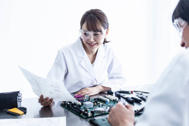 Female researchers are looking at the materials. stock photo