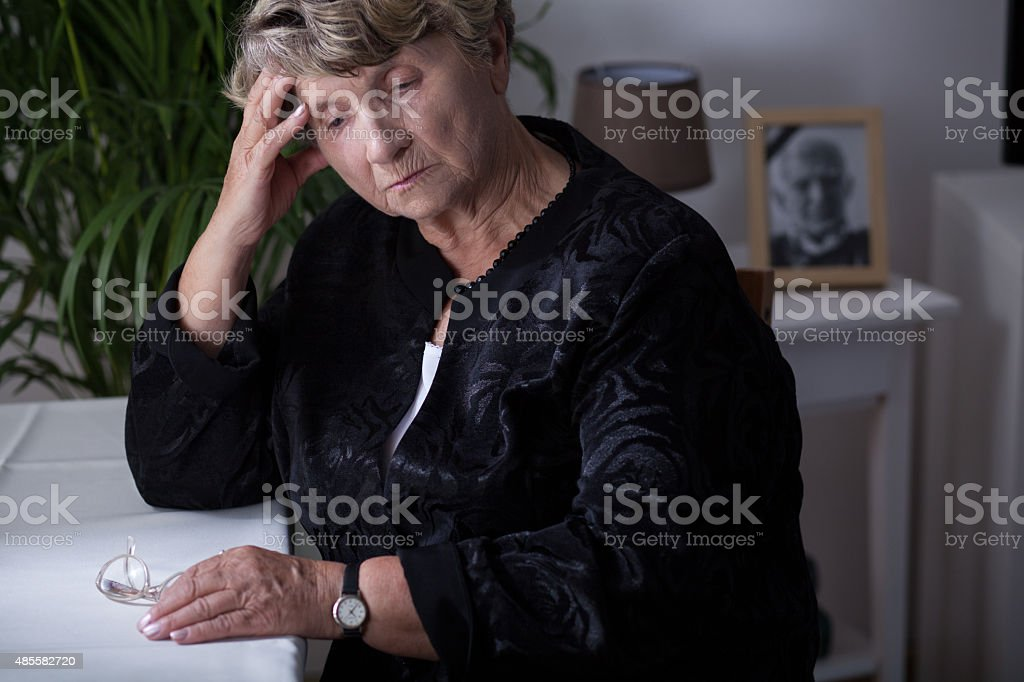 Female retiree being in mourning stock photo