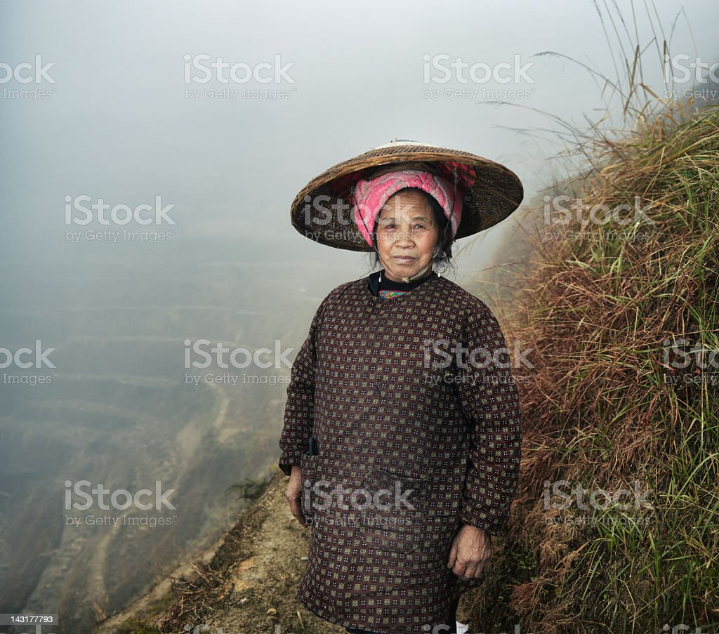 Female Rice Farmer on paddy fields royalty-free stock photo