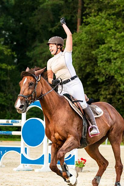 Female rider celebrates winning holding up hand picture id591420258?b=1&k=6&m=591420258&s=612x612&w=0&h=ifp72yluke2pgbcqa36nku2mbsxrv9jrpi2nh mixj0=