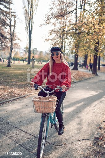 Female Riding Her Bicycle During Autumn In Park