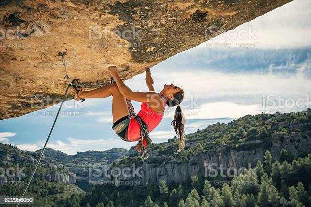 Young woman rock climbing in Margalef Catalonia Spain