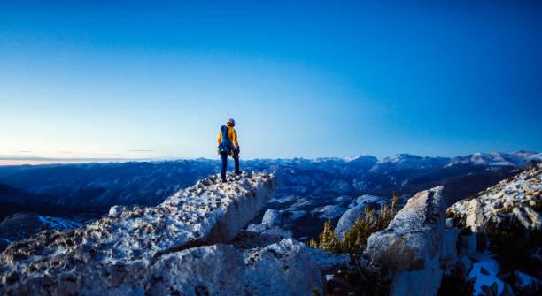 Female rock climber leading in Yosemite national park in california stock photo