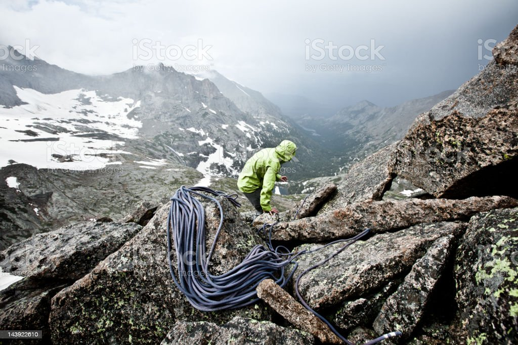 Female rock climber on a Stormy Summit in Colorado royalty-free stock photo