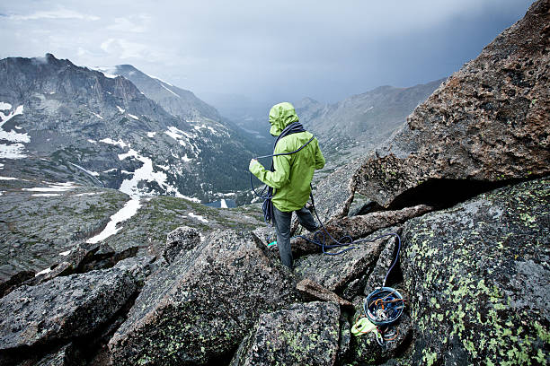Female rock climber on a Stormy Summit in Colorado stock photo