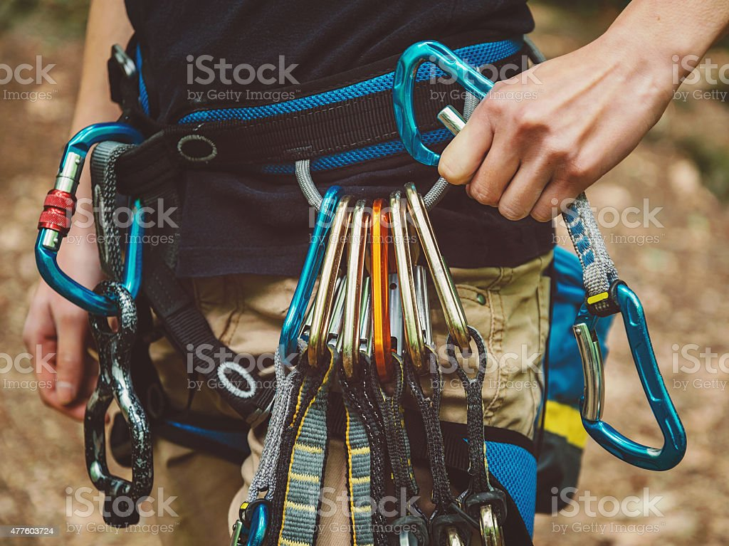 Female rock climber wearing safety harness stock photo