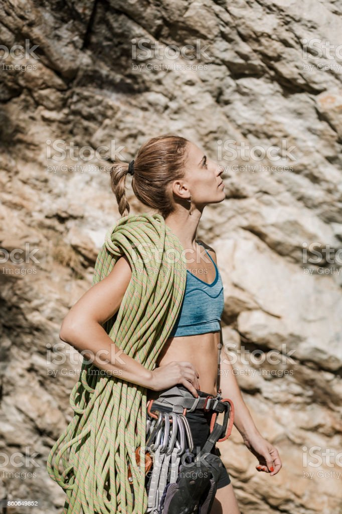 Female rock climber with climbing rope stock photo