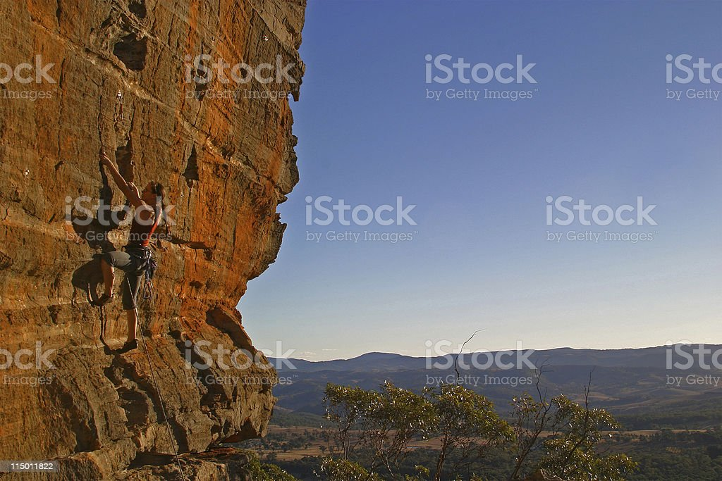 Female Rockclimber - late afternoon stock photo