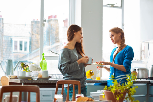 Female Roommates Stock Photo - Download Image Now