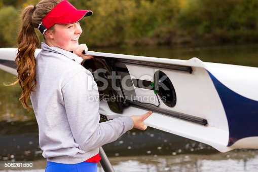 istock Female rower putting her boat in the water 508261550
