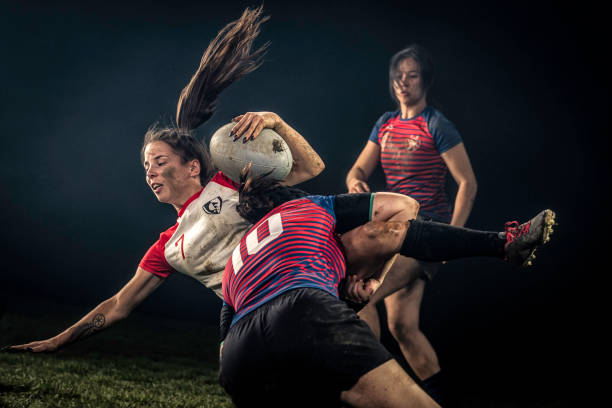 Female rugby player getting tackled