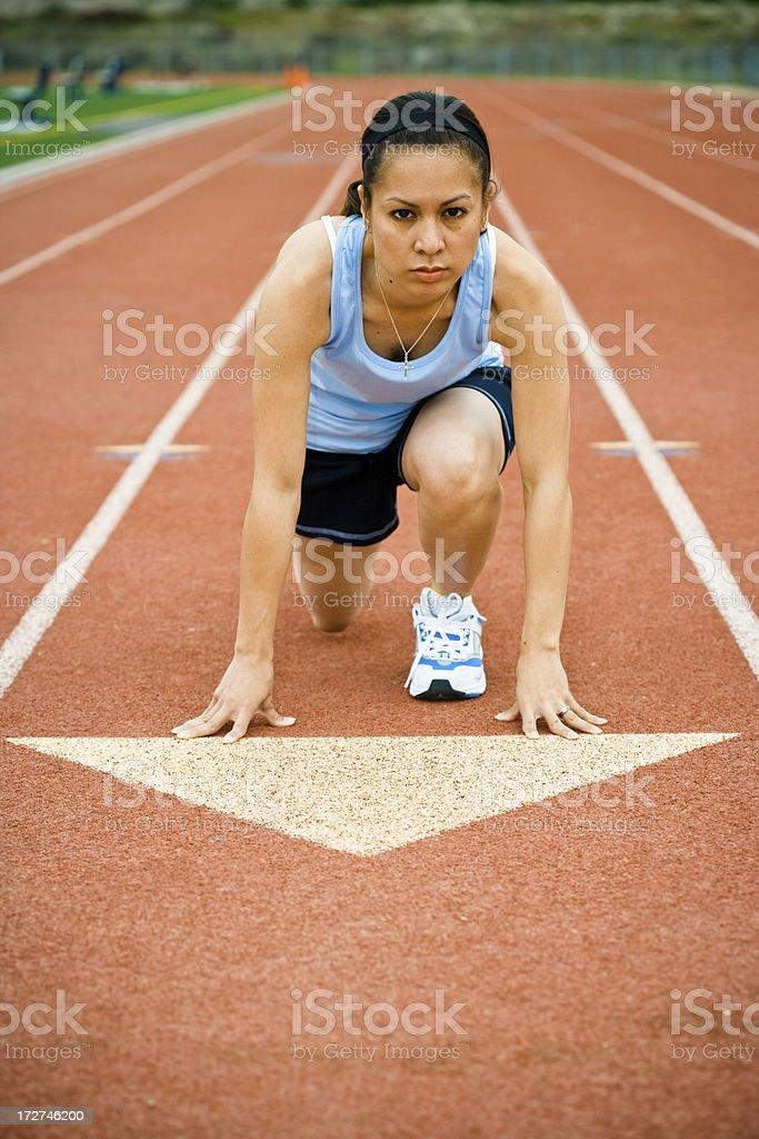 female runner at starting line (vertical) royalty-free stock photo