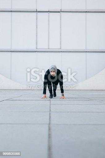 istock Female runner at starting position 999805566