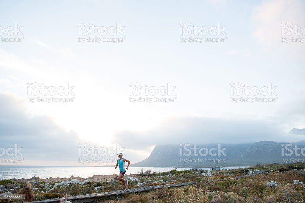 Female runner enjoying nature at its best stock photo