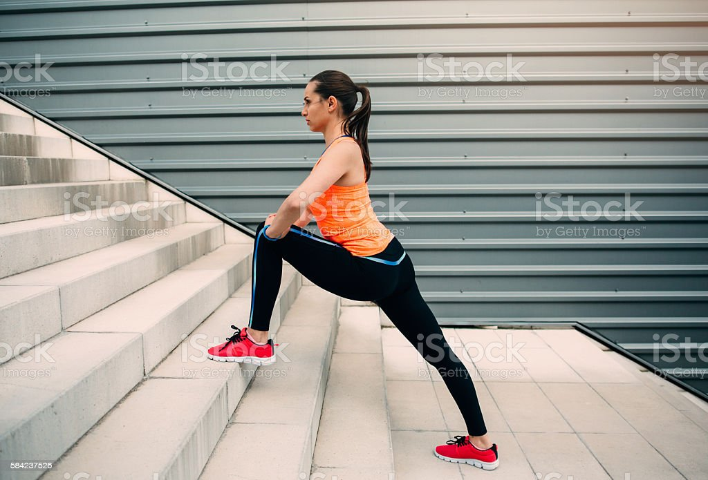 Female runner exercising stock photo