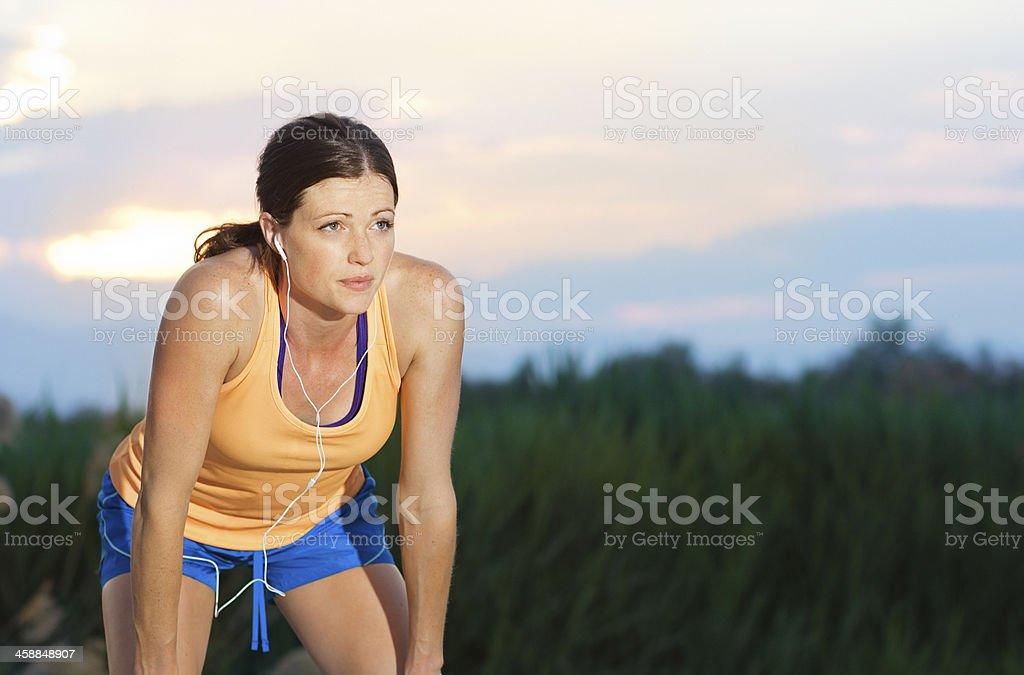 Female Runner finishing a run stock photo